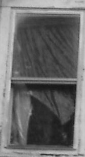 Mans face in upper window