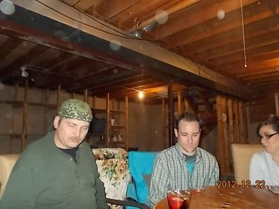 My sister took this picture while the family was playing poker and there are lots of orbs in the air around them.