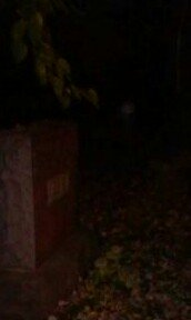 orb to the right of headstone
