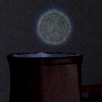 Face in Orb over lamp